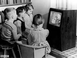 kids watching tv at night. children watching television. kids tv at night