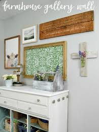 this farmhouse gallery wall has the perfect mix of neutral with a little bit of color