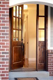 Wooden french doors add class to this brick home's entryway
