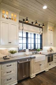 love the roman shades and the lights above the window off white kitchen with grey quartz countertop the surrounding countertops are grey expo quartz