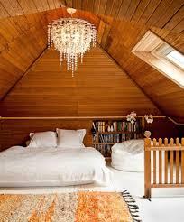 attic lighting. wooden attic bedroom with chandelier and skylight different types of lighting fixtures