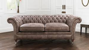 impressive chesterfield sofa design features beige color tufted sofa and leather sofa with two seaters