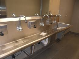 unique vanity faucets and sleek trough sink design for bathroom feat large wall mirror idea personalize