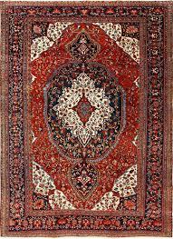 antique red background sarouk farahan persian rug 51095 nazmiyal