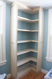 maximize corner space with corner built in shelving