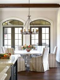 whitewashed round dining table white round trestle dining table with striped french dining chairs whitewashed round