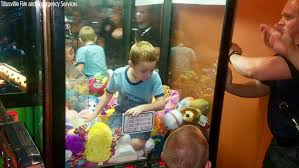 Kid Stuck In Vending Machine Simple Boy Gets Stuck In Claw Machine Trying To Reach A Toy Abc48