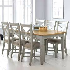 large extending dining table painted light grey 6 chairs seats 8
