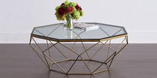 glass top coffee table with slatted metal base designs