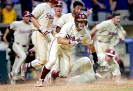 florida state s mike salvatore reacts after crossing home plate to score the winning run against lsu in the 12th inning of game 2 of the ncaa college