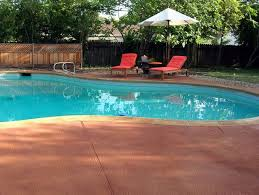resurfaced pool deck patio lake  images about pool and patio on pinterest wall fountains travertine pa