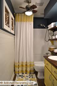 small bathroom makeover with diy ruffled shower curtain open shelves mosaic tile mirror