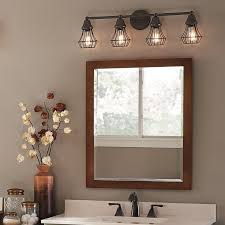 bring an element of cool into your bathroom with a bronze finish cage light fixture