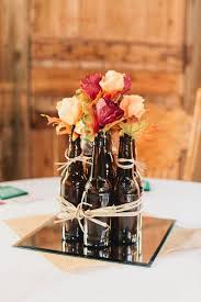 I mean, how AWESOME are these beer bottles used as centerpieces? {Andrew +