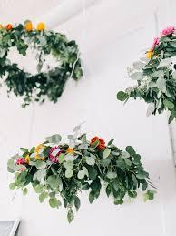 How to make chandeliers Mason Jar Fiftyflowers Floral Chandeliers Fiftyflowerscom Diy Floral Chandelier Fiftyflowers