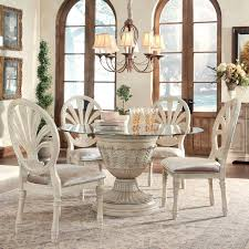 dining room sets at unbeatable s ortanique 5 piece gl top table set by ashley millennium available soon at royal furniture