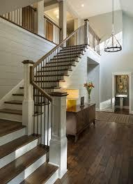 Entryway with rustic wood floors, L-shaped stairway, shiplap wall, rustic  chandelier