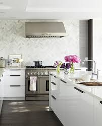 View in gallery White kitchen with purple flower arrangements
