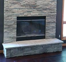 refacing painted brick fireplace with stone veneer around the modification for pictures of