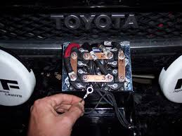 i need help with winch solenoid wiring (photo) toyota fj Old Ramsey Winch Wiring Diagram 3 Wire Winch Motor Wiring Diagram the hole through the end clip is the same diameter as the posts the copper bars are mounted to the wire is white and coming from the plug for the remote