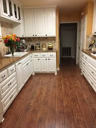 feather step laminate. Interesting Step A Beautiful Kitchen Remodel Featuring Feather Step Road House Hickory  Laminate Laminate Kitchen Remodel Flooring Hickory With H