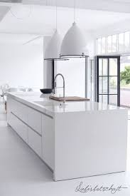 This Modern, White Kitchen Is Complete With A Glossed Finish.