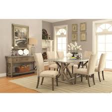 transitional style dining table with metal top and nailhead trim