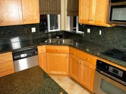 Medium Oak Kitchen Cabinets Ivory Oak Kitchen Cabinet With Black Granite Counter Tops And Back