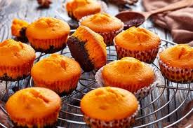 freshly <b>baked</b> delicious sweet pumpkin muffins on a <b>Round Stainless</b>..