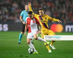 L R Nicolae Stanciu (Slavia) and Arthur (Barcelona) in action during the  Football Champions League,