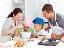 Family Kitchen Adorable Family Baking Together In The Kitchen Stock Photo
