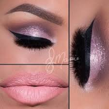 makeup soft pinks thick eyeliner pink shadow with glitter which adds sparkle and glamour and lastly pink lips to make the look more natural