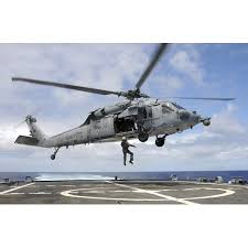A Naval Aircrewman Is Hoisted Into An Mh 60s Sea Hawk Helicopter Poster Print