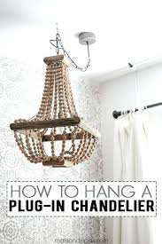 how to hang a plug in chandelier chandeliers spaces and lights how to hang a chandelier