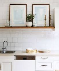 white kitchen with art and open shelves
