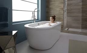 woman taking a bath in her freestanding bathtub