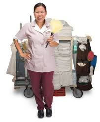 hotel housekeeper with cleaning supplies housekeeping job duties
