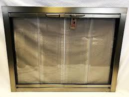 portland slim fyre glass fireplace door bi fold antique brass finish 36