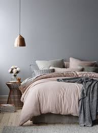 a girlish bedroom with a copper pendant lamp that completes the color scheme in a perfect