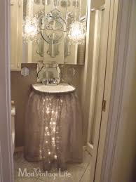 love the sink skirt with lights underneath diffe from mod vintage life glam bathroom