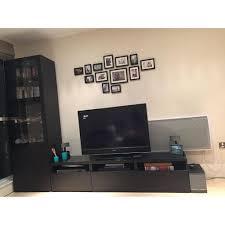 ikea besta tv storage combination wall unit in black brown with glass doors