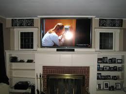 baby nursery beautiful ideas about tv above fireplace sliding doors over interior design fireplace
