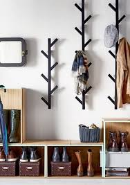 Avoid entryway clutter with open storage boxes for shoes and racks for hats  and jackets.