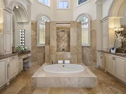 luxury bathroom with step in bathtub and sahara gold marble