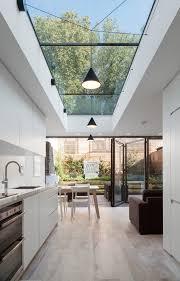 Light wooden floor kitchen contemporary with black pendants long skylight  light wooden floors