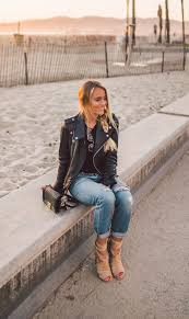 janni deler is wearing a classic leather biker jacket here bringing back a retro fifties