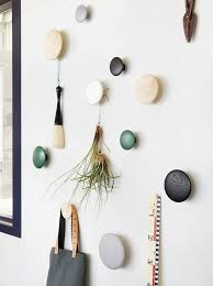 Besides being practical and functional, these Dot Coat Hooks from Muuto  will add a fun