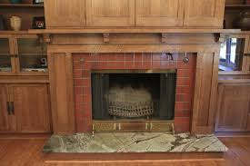 custom woodworking fireplace mantel with bookcases and television cabinet craftsman living room