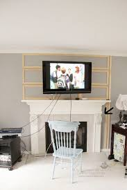 how to hide tv cords over a fireplace