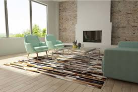 white brown and black patchwork cowhide rug in stripes
